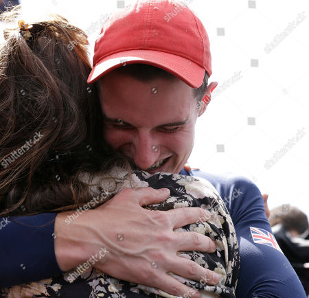 Great Britain's Peter Wilson hugs his girlfriend Michelle McCullagh after winning gold in the men's double trap, at the 2012 Summer Olympics, in London