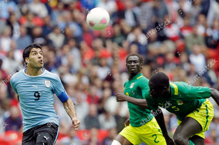 Luis Suarez, Saliou Ciss, Papa Gueye Uruguay's Luis Suarez (8) heads the ball past Senegal's Saliou Ciss (2) and Senegal's Papa Gueye, right, during a men's first-round group A soccer match at the 2012 Summer Olympics, at Wembley Stadium in London