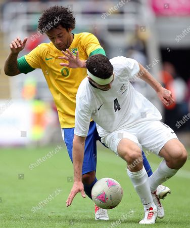Brazil's Marcelo, left, vies for the ball with New Zealand's Tim Myers, right, during the group C men's soccer match at St James' Park in Newcastle, England, during the London 2012 Summer Olympics