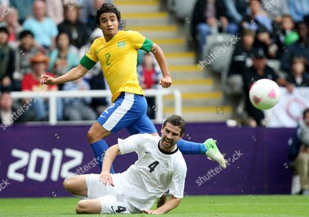 Brazil's Rafael, top, vies for the ball with New Zealand's Tim Myers, bottom, during the group C men's soccer match at St James' Park in Newcastle, England, during the London 2012 Summer Olympics