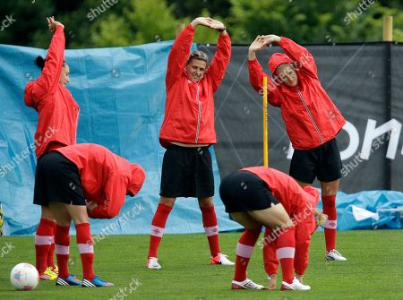 Canada's Kaylyn Kyle, right, trains with teammates Christine Sinclair, center, and Lauren Sesselmann, left, during a women's soccer training session for the 2012 London Summer Olympics, in Coventry, England