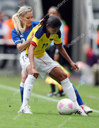 France's Laure Boulleau, left, vies for the ball with Colombia's Yulieht Dominguez, right, during the group G women's soccer match at St James' Park in Newcastle, England, during the London 2012 Summer Olympics