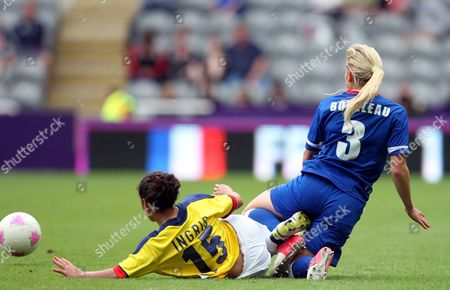 France's Laure Boulleau (3) vies for the ball with Colombia's Ingrid Vidal (15) during the group G women's soccer match at St James' Park in Newcastle, England, during the London 2012 Summer Olympics