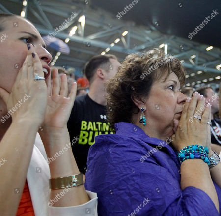 Debbie Phelps watches as her son United States swimmer Michael Phelps competes in the men's 4 X 100-meter medley relay at the Aquatics Centre in the Olympic Park during the 2012 Summer Olympics, London