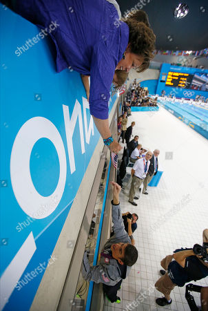 Michael Phelps Debbie Phelps hands a United States flag to her son Michael Phelps after the the men's 4 X 100-meter medley relay at the Aquatics Centre in the Olympic Park during the 2012 Summer Olympics, London