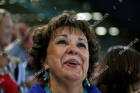 Debbie Phelps, mother of United States swimmer Michael Phelps, reacts following the national anthem for the men's 4 X 100-meter medley relay at the Aquatics Centre in the Olympic Park during the 2012 Summer Olympics, London