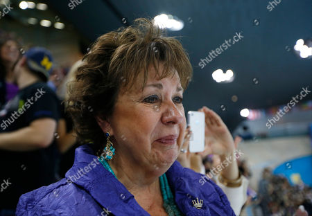 Debbie Phelps, mother of United States swimmer Michael Phelps, cries following the national anthem for the men's 4 X 100-meter medley relay at the Aquatics Centre in the Olympic Park during the 2012 Summer Olympics, London