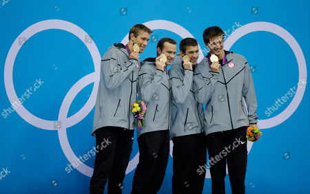 Michael Phelps United States' men's 4 X 100-meter medley relay team from left, Matthew Grevers, Brendan Hansen, Michael Phelps and Nathan Adrian hold their gold medals at the Aquatics Centre in the Olympic Park during the 2012 Summer Olympics in London