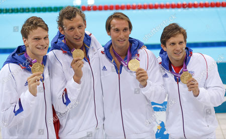 France's men's relay swim team members from left Yannick Agnel, Amaury Leveaux, Fabien Gilot, and Clement Lefert hold their gold medals after their win in the men's 4x100-meter freestyle relay final at the Aquatics Centre in the Olympic Park during the 2012 Summer Olympics in London