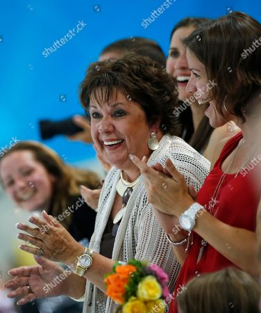 Debbie Phelps, left, and Whiney, right, mother and sister respectively of United States' Michael Phelps, applaud after the medal ceremony where Phelps received the gold for the men's 100-meter butterfly swimming final at the Aquatics Centre in the Olympic Park during the 2012 Summer Olympics, London