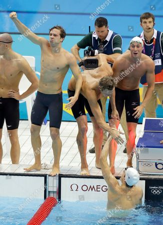 France's Clement Lefert, left, Amaury Leveaux, center, and Fabien Gilot, right, celebrate as they win gold in the men's 4x100-meter freestyle relay final at the Aquatics Centre in the Olympic Park during the 2012 Summer Olympics in London