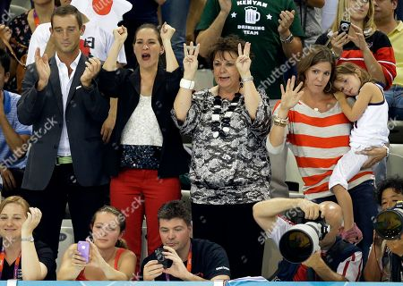 Debbie Phelps, center, the mother of United States' Michael Phelps celebrates after he won gold in the men's 200-meter individual medley swimming final at the Aquatics Centre in the Olympic Park during the 2012 Summer Olympics in London