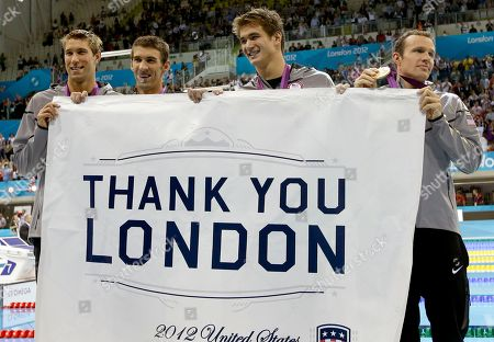 Michael Phelps United States' men's 4 X 100-meter medley relay team from left, Matthew Grevers, Michael Phelps, Nathan Adrian and Brendan Hansen pose with a banner thanking London after their gold medal win in the men's 4 x 100-meter medley relay at the Aquatics Centre in the Olympic Park during the 2012 Summer Olympics in London