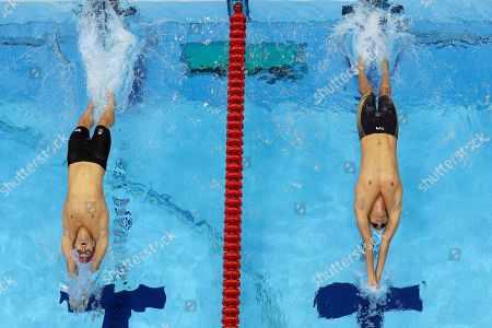 Britain's Liam Tancock, left, and France's Camille Lacourt start in a men's 100-meter backstroke swimming heat at the Aquatics Centre in the Olympic Park during the 2012 Summer Olympics in London