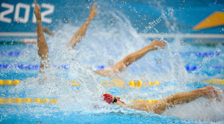 Britain's Liam Tancock, front, competes in a men's 100-meter backstroke swimming heat at the Aquatics Centre in the Olympic Park during the 2012 Summer Olympics in London