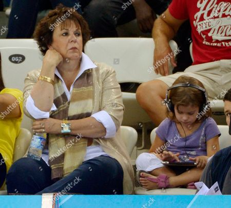 United States' Michael Phelps' mother Debbie Phelps, left, watches men's 100-meter butterfly swimming heats at the Aquatics Centre in the Olympic Park during the 2012 Summer Olympics in London