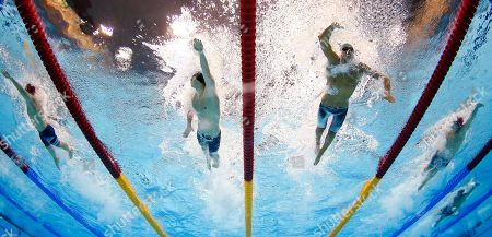From left, Britain's Daniel Fogg, Hungary's Gergo Kis, Italy's Gregorio Paltrinieri and Poland's Mateusz Sawrymowicz compete in a 1500-meter freestyle swimming heat at the Aquatics Centre in the Olympic Park during the 2012 Summer Olympics in London