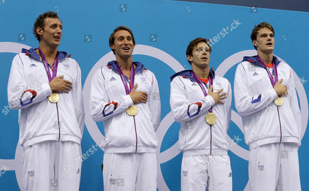 From left, France's Amaury Leveaux, France's Fabien Gilot, France's Clement Lefert and France's Yannick Agnel sing the national anthem after receiving their gold medals for the men's 4x100-meter freestyle relay final at the Aquatics Centre in the Olympic Park during the 2012 Summer Olympics in London