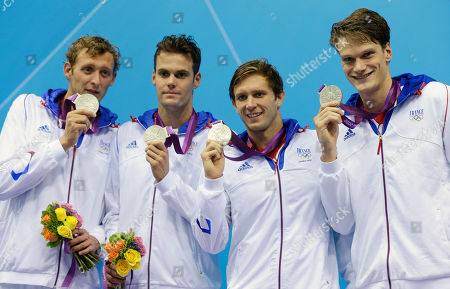From left, France's Amaury Leveaux, France's Gregory Mallet, France's Clement Lefert and France's Yannick Agnel pose with their silver medals for the men's 4x200-meter freestyle relay swimming final at the Aquatics Centre in the Olympic Park during the 2012 Summer Olympics in London