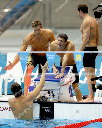 Michael Phelps United States' men's 4 X 100-meter medley relay team from left, Matthew Grevers, Michael Phelps and Brendan Hansen shake hands with teammate Nathan Adrian after winning the gold medal at the Aquatics Centre in the Olympic Park during the 2012 Summer Olympics in London