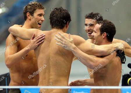 Michael Phelps United States' men's 4 X 100-meter medley relay team from left, Matthew Grevers, Nathan Adrian, Michael Phelps and Brendan Hansen embrace after winning the gold medal at the Aquatics Centre in the Olympic Park during the 2012 Summer Olympics in London