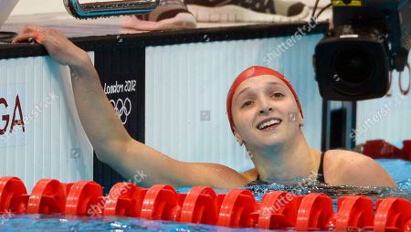 Britain's Caitlin McClatchey reacts after competing in a women's 200-meter freestyle swimming heat at the Aquatics Centre in the Olympic Park during the 2012 Summer Olympics in London