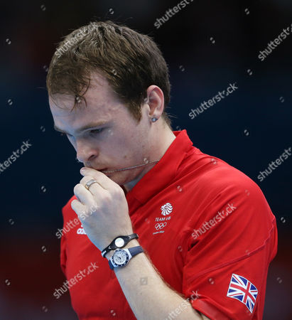 Paul Drinkhall of Great Britain pauses while competing against Zi Yang of Singapore in the men's singles table tennis at the 2012 Summer Olympics, in London
