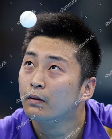 Zi Yang of Singapore competes against Paul Drinkhall of Great Britain in the men's singles table tennis at the 2012 Summer Olympics, in London