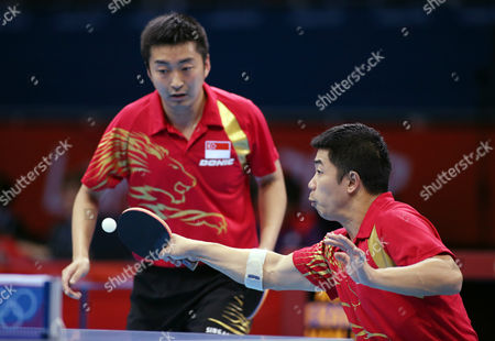 Jian Zhan, right, and Zi Yang of Singapore compete against Australia during men's team table tennis competition at the 2012 Summer Olympics, in London