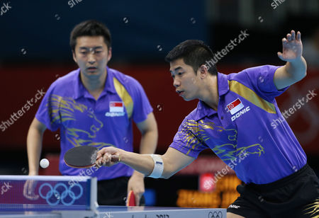 Singapore's Jian Zhan, right, and Zi Yang compete against a team from China in the men's team quarterfinals table tennis match at the 2012 Summer Olympics, in London