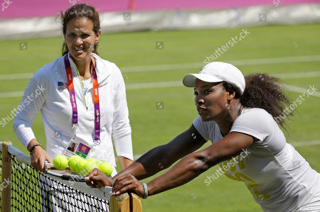 Serena Williams, Mary Joe Fernandez Serena Williams, right, of the United States leans on the net post during training with coach Mary Joe Fernandez at the All England Lawn Tennis Club at Wimbledon, London for the 2012 Summer Olympics, . Tennis competition is scheduled to begin Saturday, July 28