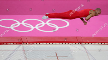 Denmark's Peter Jensen performs during the men's trampoline qualifications at the 2012 Summer Olympics, in London