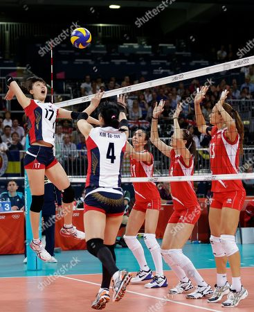 Naz Aydemir, Bahar Toksoy, Neriman Ozsoy, Yang Hyo-jin, Kim Sa-nee South Korea's Yang Hyo-jin (17) takes a pass from teammate Kim Sa-nee (4) to spike the ball towards Turkey defenders Naz Aydemir (11), Bahar Toksoy (8), and Neriman Ozsoy (13) during a women's volleyball preliminary match at the 2012 Summer Olympics, in London