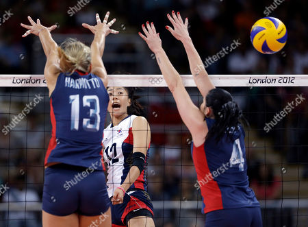 Christa Harmotto, Lindsey Berg, Han Song-Yi South Korea's Han Song-Yi, center, spikes the ball past United States' Christa Harmotto, left, and Lindsey Berg during a women's preliminary volleyball match at the 2012 Summer Olympics, in London