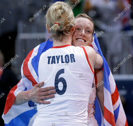 Lynne Beattie, Jennifer Taylor Britain's Jennifer Taylor (6) and teammate Lynne Beattie hug after their team defeated Algeria in a women's preliminary volleyball match at the 2012 Summer Olympics, just after midnight, in London