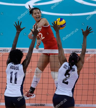 Zeng Chunlei, Megan Hodge, Danielle Scott-Arruda China's Zeng Chunlei, top, spikes the ball between United States' Megan Hodge (11) and Danielle Scott-Arruda (2) during a women's preliminary volleyball match at the 2012 Summer Olympics, in London