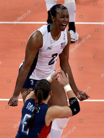 Danielle Scott-Arruda, Nicole Davis United States' Danielle Scott-Arruda, top, and Nicole Davis celebrate during a women's preliminary volleyball match against China at the 2012 Summer Olympics, in London