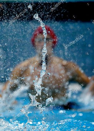 Water splashes as Great Britain goalkeeper Ed Scott defends his net against Romania in a preliminary water polo match at the 2012 Summer Olympics, in London. Romania won 13-4