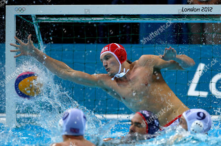 Ed Scott Ed Scott of Great Britain is unable to stop a shot by Anthony Azevedo of the United States during a preliminary men's water polo match at the 2012 Summer Olympics, in London