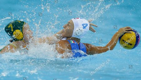 Federica Radicchi, right, of Italy, shields the ball from Rowie Webster of Australia during their women's water polo preliminary round match at the 2012 Summer Olympics, in London