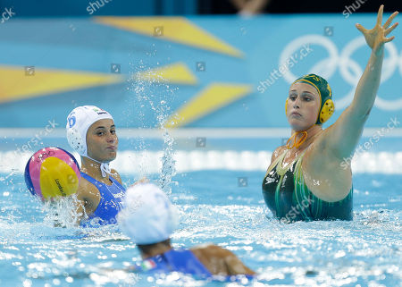 Allegra Lapi, left, of Italy passes the ball as Holly Lincoln-Smith of Australia defends during their women's water polo preliminary round match at the 2012 Summer Olympics, in London