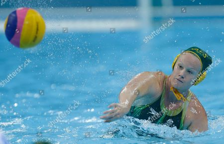Rowie Webster of Australia shoots at goal during their women's water polo preliminary round match against Italy at the 2012 Summer Olympics, in London