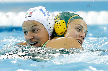 Aleksandra Cotti of Italy, left, swims into Nicola Zagame of Australia during their women's water polo preliminary round match at the 2012 Summer Olympics, in London