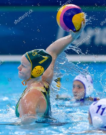 Rowie Webster of Australia shoots at goal during their women's water polo preliminary round match against Russia at the 2012 Summer Olympics, in London