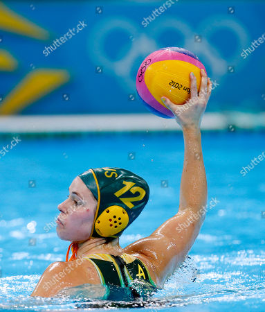 Nicola Zagame of Australia, holds the ball ready to pass forward during their women's water polo preliminary round match against Russia at the 2012 Summer Olympics, in London