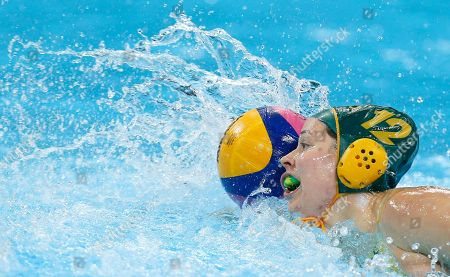 Nicola Zagame of Australia push the ball along as her team plays China during their women's water polo quarterfinal match at the 2012 Summer Olympics, in London