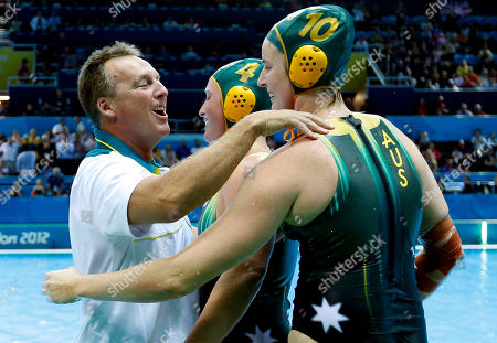 Head Coach of the Australian women's water polo team Greg McFadden, left celebrates with two of his team Holly Lincoln-Smith, center, and Ash Southern after they defeated China in a penalty shoot-out in their women's water polo quarterfinal match at the 2012 Summer Olympics, in London