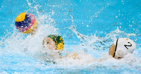 Nicola Zagame, left, of Australia, pushes the ball forward to score as Teng Fei of China attempts to intercept during their women's water polo quarterfinal match at the 2012 Summer Olympics, in London