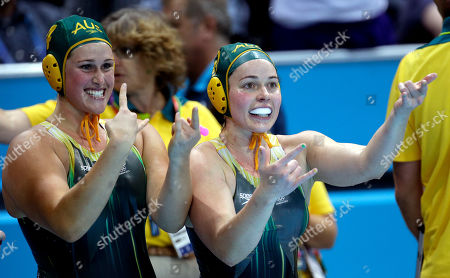 Holly Lincoln-Smith, Nicola Zagame Australia's Holly Lincoln-Smith, left, and Nicola Zagame gesture toward the stands as they celebrate a 10-8 victory over Italy during a preliminary women's water polo match at the 2012 Summer Olympics, in London