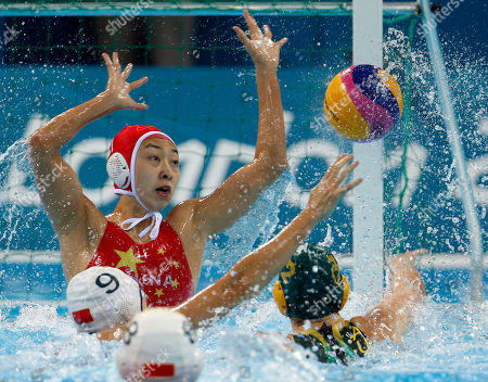 Nicola Zagame, Yang Jun Nicola Zagame of Australia, right, scores a goal against goalkeeper Yang Jun of China during their women's water polo quarterfinal match at the 2012 Summer Olympics, in London